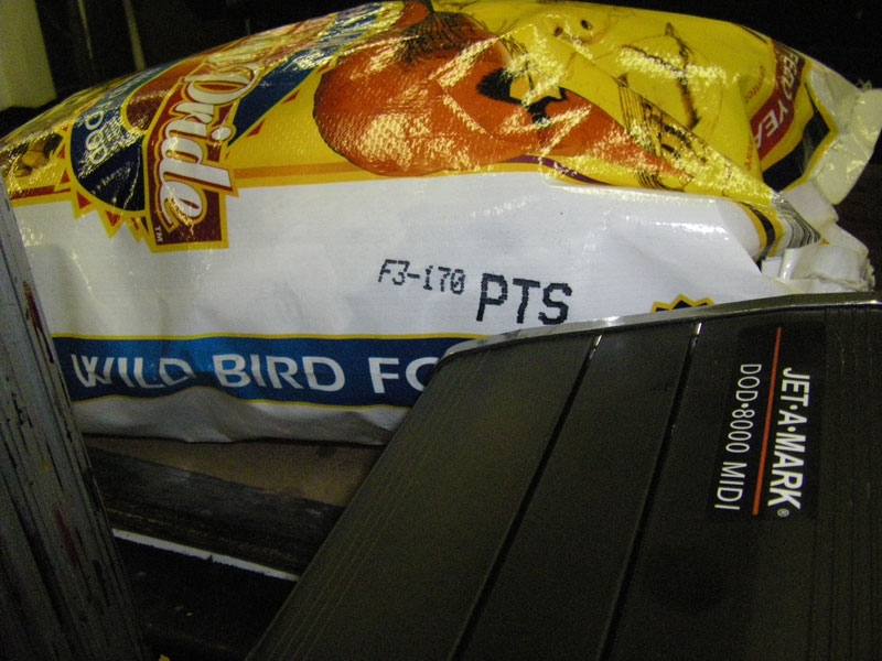 drop-on-demand inkjet marking system printing mark and code on plastic bird feed bird seed bag