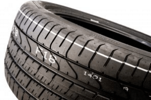 Rubber tire with code printed on tread, mark made with Matthews Marking System